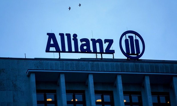 The Allianz SE logo sits on a top of a building in Berlin, Germany, on Wednesday, Jan. 4, 2017. Germany had another year of firm growth in 2016 and should continue to be propelled in 2017 by consumer spending. (Photo: Krisztian Bocsi/Bloomberg)