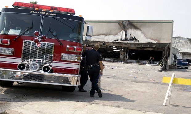 A commercial tenant's exposure after a fire in a leased workplace is the possible loss of use of that space. Here,firefighters survey the site of a deadly furniture store fire in Charleston, South Carolina. (Mahmood Fazal/Bloomberg News)