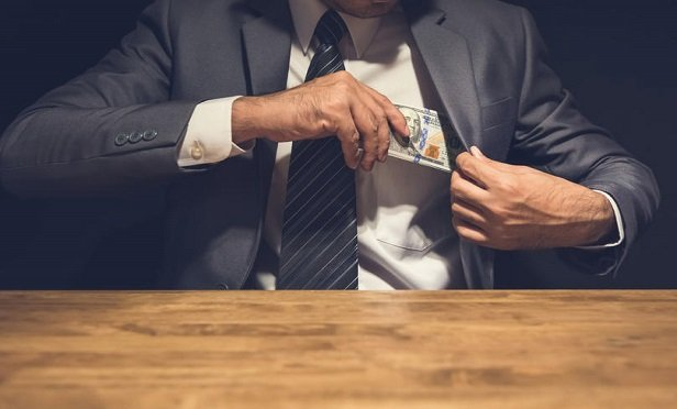 Evidence obtained by investigators revealed that victims' funds were deposited into Fortis Financial and Legacy Group Financial, and no WCMSA accounts were ever established. (Credit: Atstock Productions/Shutterstock)