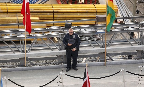 A first responder observes a moment of silence during a ceremony at Ground Zero, the 16-acre World Trade Center site, in New York, U.S., on Thursday, Sept. 11, 2008. (Photo: Andrew Harrer/Bloomberg News)