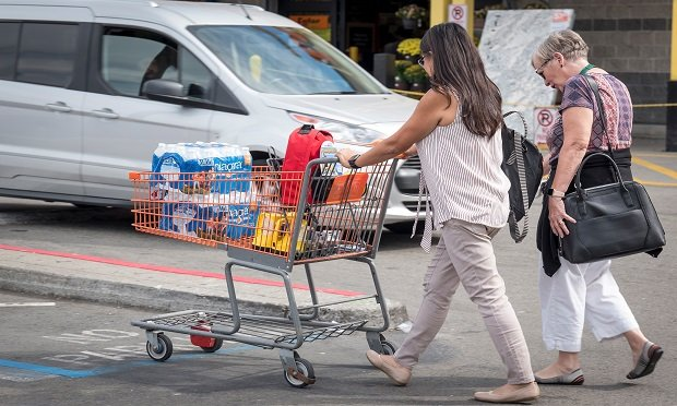 A customer pushes a shopping cart with bottled water, flashlights, and batteries in a Home Depot Inc. parking lot in Emeryville, California, U.S., on Tuesday, Oct. 8, 2019.  (Photo: David Paul Morris/Bloomberg)