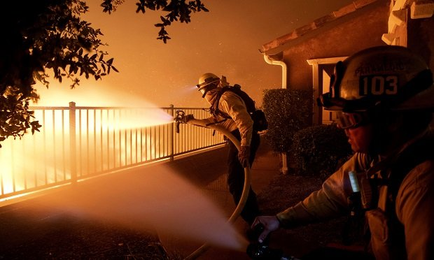 In this Thursday, Oct. 10, 2019, photo, Los Angeles City firefighters battle the Saddleridge fire near homes in Sylmar, Calif. (Photo:AP Photo/Michael Owen Baker)