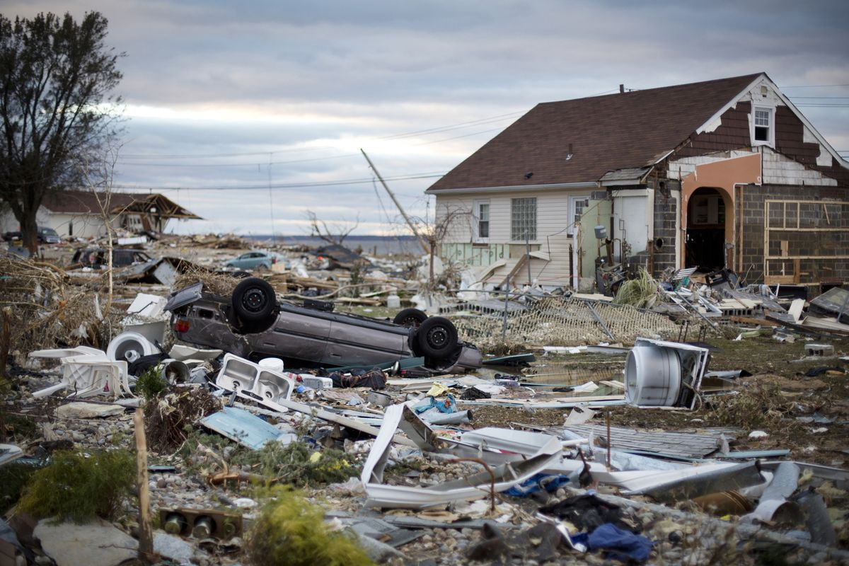 An overturned car sits amidst debris from houses destroyed during Hurricane Sandy in Union Beach, New Jersey, U.S. on Saturday, Nov. 3, 2012. (Photo: Victor J. Blue/Bloomberg)