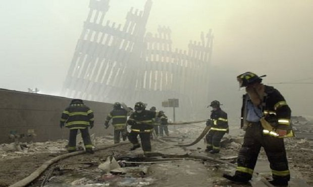 Firefighters work beneath the destroyed mullions, the vertical struts which once faced the soaring outer walls of the World Trade Center towers, after a terrorist attack on the twin towers in New York, on Sept. 11, 2001.