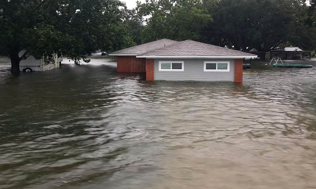 An estimated 62 million homes should have flood insurance. But only 5.1 million do. With coverage as low as $1 per day, logic, not laws, should prevail. In this photo, floodwaters from Tropical Depression Imelda surround a home in Winnie, Texas.  (Brian Hawthorne/Chambers County Sheriff's Office via AP)
