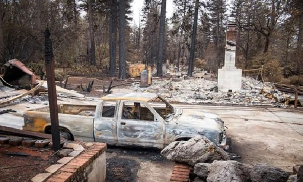A burned-out vehicle is seen near destroyed homes in Paradise, California, U.S., on Monday, Nov. 26, 2018. The nation's deadliest wildfire in a century known as the Camp Fire that killed at least 85 people and burned over 14,000. (Photo: David Paul Morris/Bloomberg)