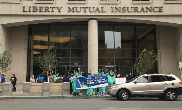 According to RAN, Liberty Mutual is a top global insurer of coal, oil and gas. Their white paper says the company invests more than $6.6 billion in fossil fuel companies, including $1.5 billion in thermal coal. (Photo: Courtesy of Rainforest Action Network/Anton A.)