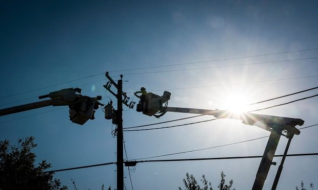 Workers for Source Power Services, contracted by Pacific Gas & Electric (PG&E), repair a power transformer in Healdsburg, California, U.S., on Thursday, Oct. 31, 2019. While the extreme winds were forecast to ease, wildfire risks will remain high through Friday, according to the U.S. Storm Prediction Center. Photographer: David Paul Morris/Bloomberg