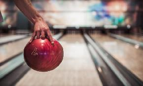 Workers' comp benefits awarded to woman injured bowling with co workers