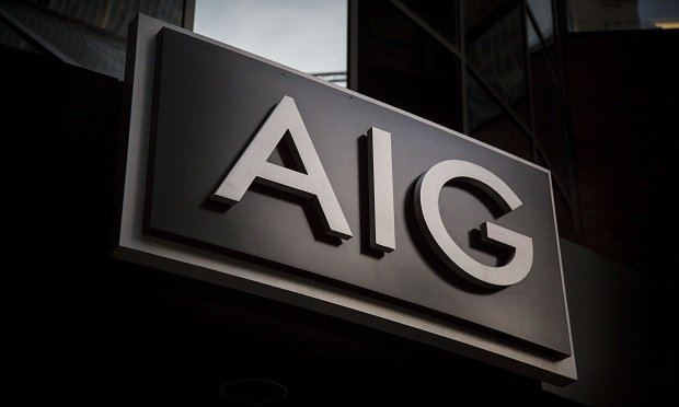 American International Group Inc. (AIG) signage stands outside the company's headquarters in New York, U.S., on Thursday, Oct. 29, 2015. (Photo:: Michael Nagle/Bloomberg)