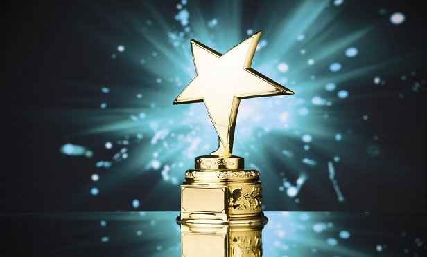 gold star trophy against blue sparks backgrounAgilius, Prostosure and Sigo took top honors in the 2020 InsurTech Competition. (iStock)