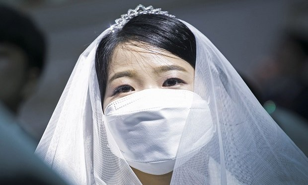 GAPYEONG-GUN, SOUTH KOREA - FEBRUARY 07: Thousands of couples attend a mass wedding held by the Family Federation for World Peace and Unification, aka Unification Church despite the spread of the 2019 Novel Coronavirus also known as Wuhan Coronavirus on February 7, 2020 in Gapyeong-gun, South Korea. Some 4,000 'Moonies', believers of Unification Church, which was named after the founder Moon Sun Myung, attend the mass wedding which began in the early 1960s. On this day China's National Health Commission raised the death toll from the virus from the virus to 636 from 563, global total is 638. (Photo by Woohae Cho/Getty Images)