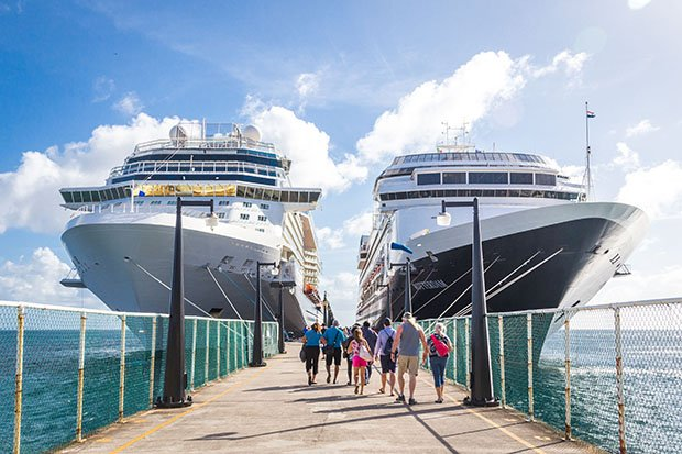 Cruise-ships-side-by-side-at-pier-with-passengers