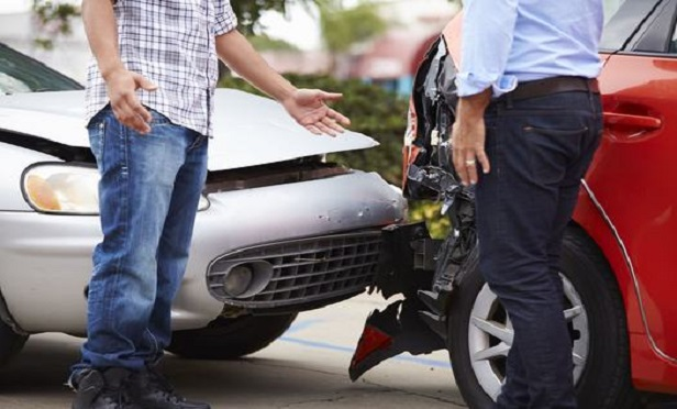 Two men discussing an auto accident.