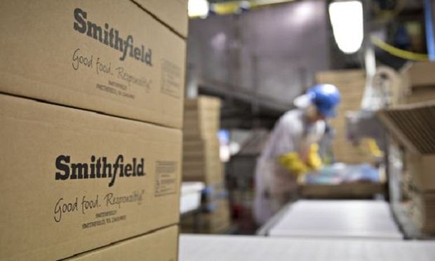 The Smithfield Foods Inc. logo is displayed on boxes at the company's pork processing facility in Milan, Missouri, U.S., on Wednesday, April 12, 2017. (Photo: Daniel Acker/Bloomberg)