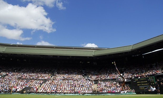 Venus Williams serves the ball to her sister, Serena Williams, during their finals match at the Wimbledon tennis championships in southwest London, U.K., on Saturday, July 5, 2008. (Photo: Alan Crowhurst/Bloomberg)