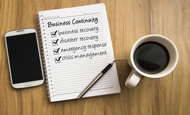 """Many employers are reaching out for pre-planning of another catastrophic event. For example, if a natural disaster like a hurricane or tornado occurred during this time — a """"cat"""" within a """"cat"""" — they want to know that their business would have a continuity plan in place. (Credit: kenary820/Shutterstock)"""