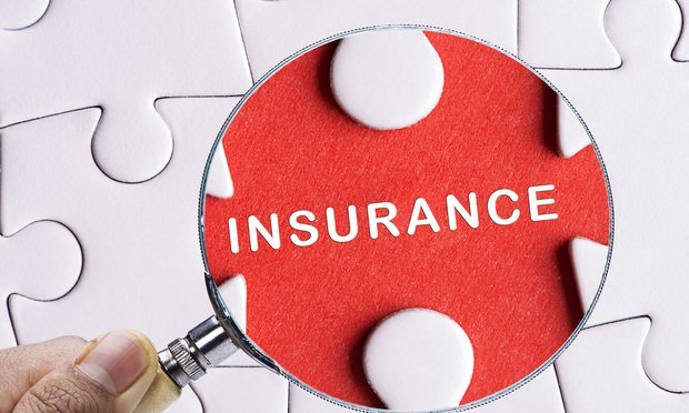 White-puzzle-pieces-red-piece-labeled-insurance-magnifying-glass