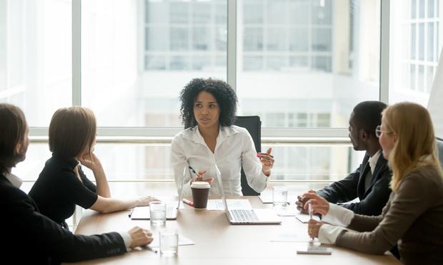 Black female boss leading business meeting