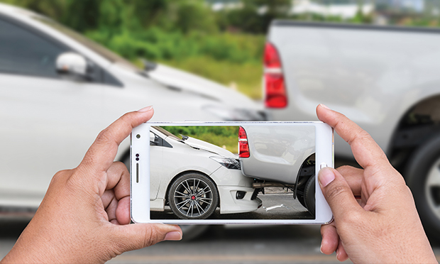 Person taking a photo of a rear-end accident.