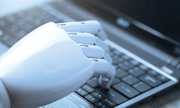 Automated hand on a keyboard.