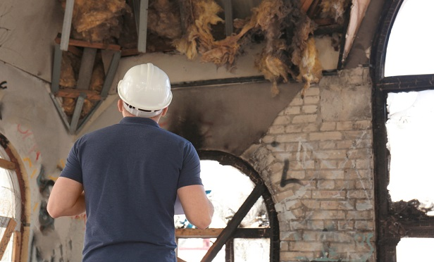 Adjuster inspecting a fire loss.
