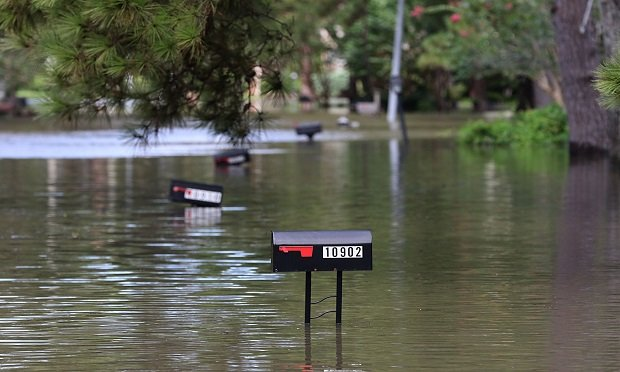 Mailboxes stick out from flood waters in Lakeside Estate in Houston, Texas on August 30, 2017. (Photo: Getty Image/AFP)