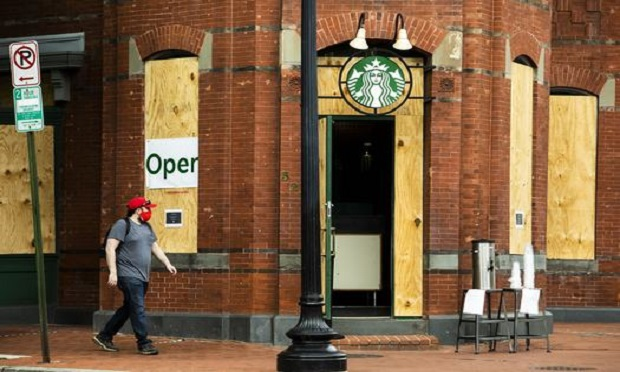 A Starbucks store, partially reopened during the Coronavirus pandemic, is boarded up to protect against vandalism during the days of demonstrations protesting the killing of George Floyd and police brutality, Washington, D.C. June 6, 2020. (Photo: Diego M. Radzinschi/ALM)