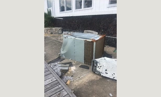 Wind can cause package units to fall to the ground and be damaged, frequently requiring replacement. (Photo Credit: HVACi)