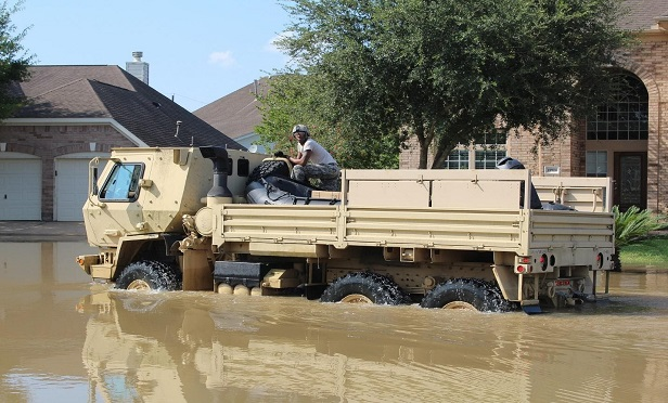 """Flooding isn't usually covered by homeowner's insurance policies, but it can still cause major damages. (Credit: """"Hurricane Harvey Flood Army,"""" by Andrewtheshrew /CC BY 4.0)"""