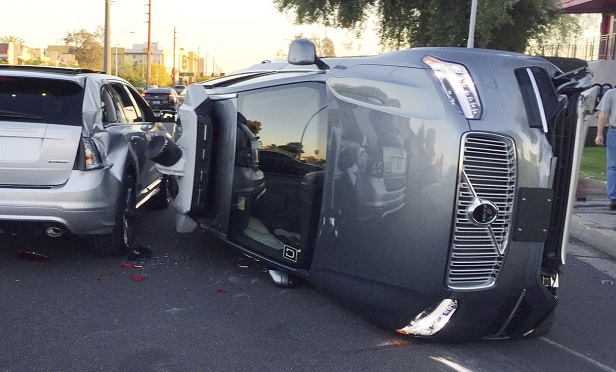 Uber self-driving SUV that flipped on its side in a collision in Tempe, Arizona on March 24, 2017. (Photo: Tempe Police Department)