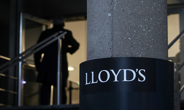 A visitor enters the Lloyd's of London Ltd. building in London, U.K. (Photo: Chris Ratcliffe/Bloomberg)
