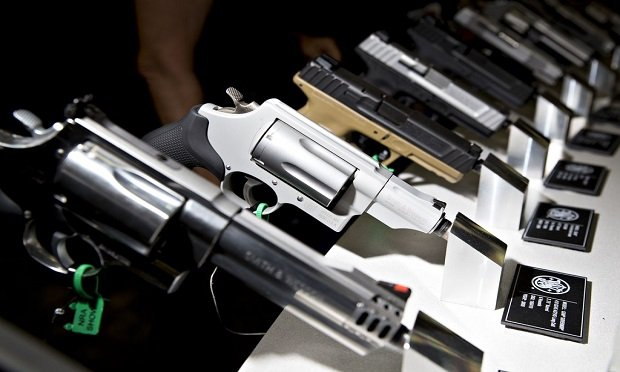 Pistols and revolvers sit on display in the Smith & Wesson Corp. booth during the National Rifle Association (NRA) annual meeting in Dallas, Texas, on May 5, 2018. (Photo: Bloomberg)