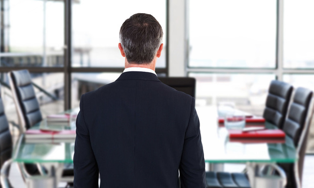 Rear view of businessman in empty conference room