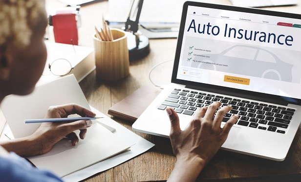 Woman purchasing auto insurance online.