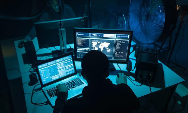 A hacker working in the dark.