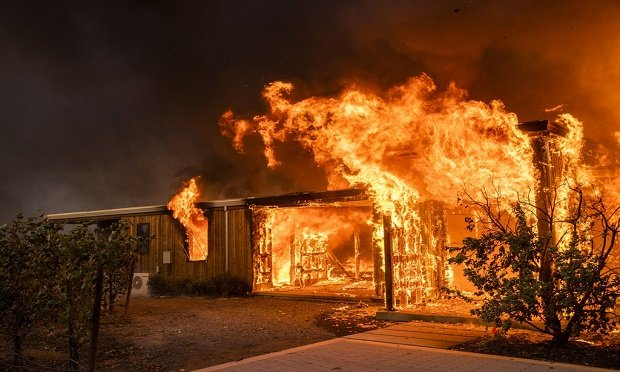 To develop a parametric insurance solution — one innovative way to address wildfire risk — a policy is structured with certain events plainly stated in order for coverage to be automatically triggered. (Photo: Phil Pacheco/Bloomberg)