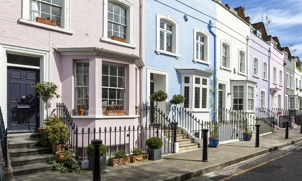 A row of multi-colored terrace houses in Chelsea, London, U.K. (Photo: iStock)