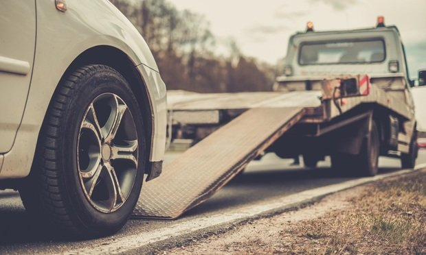 """When the damaged vehicle is finally moved to a repair or salvage facility, the job is referred to as a """"secondary tow,"""" and it's an ugly, chaotic and archaic process. It's so bad that the only remedy at this point is to start over from a clean slate and redesign the process altogether. (Credit: Bigstock)"""