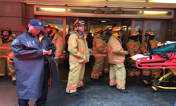 This New York Fire Department rescue team responded today to the helicopter crash at the AXA Equitable Center building. (Photo: David Handschuh/ALM)