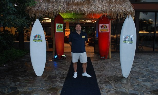 A happy man with surfboards
