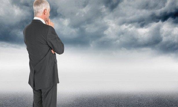 A man looking at a storm