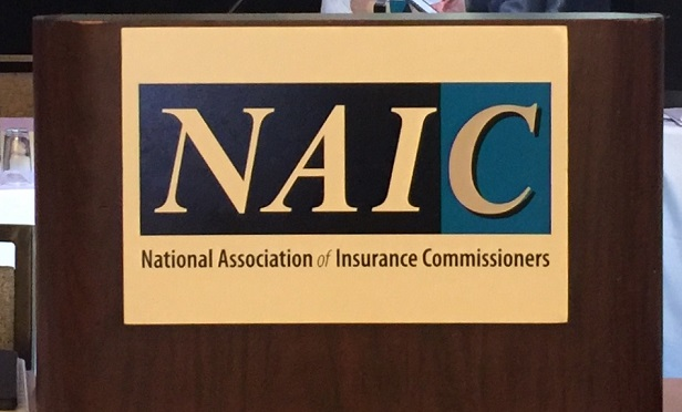 NAIC sign on a speaker's lectern