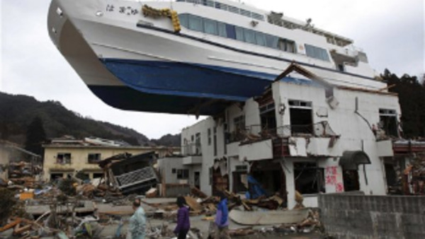 A boat sits atop a building in Otsuchi, Iwate Prefecture, Japan, Tuesday, March 22, 2011, following the March 11 earthquake and tsunami which devastated a vast area of northeastern Pacific coast of Japan. (AP Photo/Yomiuri Shimbun)