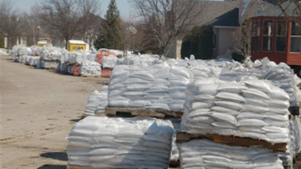 Sandbags are lined up in a street of a south Fargo, ND, neighborhood along the Red River, Tuesday, April 5, 2011. The city is bracing for yet another flood. (AP Photo/Dave Kolpack)