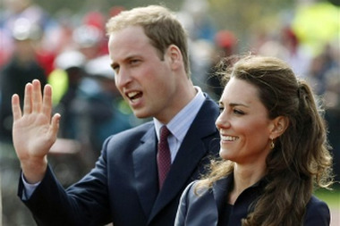 FILE - Britain's Prince William, accompanied by his fiancee Kate Middleton, arrive at Witton Country Park, Darwen, England on April 11, 2011. Prince William and Kate Middleton will marry on April 29. Britain's government says it is considering changing the rules of royal succession so that if Prince William and Kate Middleton's first child is a girl she would eventually become queen. (AP Photo/Tim Hales, File)