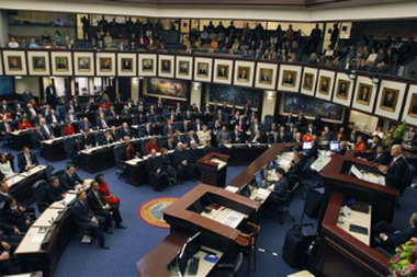 In this AP file photo, Florida Gov. Rick Scott, right, delivers a speech to the Florida legislature in Tallahassee, Fla. (AP Photo/Chris O'Meara)