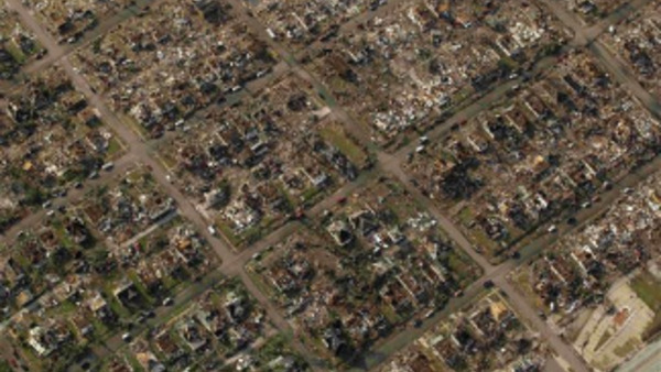 A neighborhood destroyed by a powerful tornado on Sunday is seen in Joplin, Mo. Tuesday, May 24, 2011. A tornado moved through much of the city Sunday, damaging a hospital and hundreds of homes and businesses and killing at least 116 people. (AP Photo/Charlie Riedel)