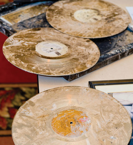 PHILADELPHIA, PA - FEBRUARY 23: Damaged gold records are displayed during a press conference detailing the fire that heavily damaged the Philadelphia International Records headquarters on February 23, 2010 in Philadelphia, Penn. Artists such as Michael Jackson, Teddy Pendergrass, Patti LaBelle, the OoJays, Lou Rawls, and Chubby Checker all have recorded at the studio. (Photo Jeff Fusco/Getty Images)