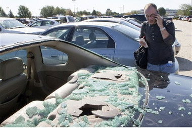 A man calls his insurance company after an August hail storm in Nebraska. The National Crime Insurance Bureau says questionable claims involving hail surged during the first hal